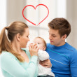 Family and adorable baby with feeding-bottle — Stock Photo #38739875