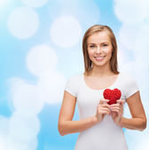 Smiling woman in white t-shirt with heart — Stock Photo