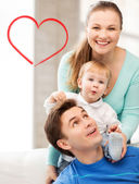 Happy parents playing with adorable baby — Stock Photo