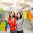 Teenage girls with shopping bags and credit card — Stock Photo #38740687