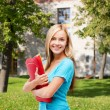 Stock Photo: Smiling student with folders