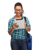 Student in eyeglasses with tablet pc and bag — Stock Photo