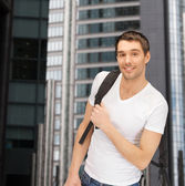 Travelling student with backpack outdoor — Stock Photo