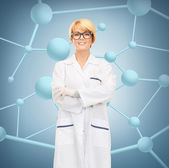 Smiling female doctor in glasses — Stockfoto
