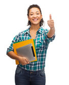 Smiling african-american student showing thumbs up — Stock Photo