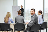 Businessman with team in office — Stock Photo