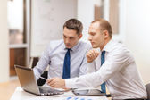 Two businessmen having discussion in office — Stock Photo