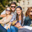 Group of students or teenagers hanging out — Stock Photo
