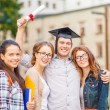 Students or teenagers with files and diploma — Stock Photo