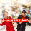 Woman and man pointing finger to red sale sign — Stock Photo #38968071