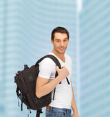Travelling student with backpack outdoor — Stockfoto
