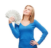 Smiling girl with dollar cash money — Stock Photo