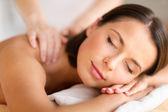 Beautiful woman in spa salon getting massage — Стоковое фото
