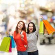 Teenage girls with shopping bags and credit card — Stock Photo #39014857
