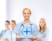 Smiling female doctor or nurse with tablet pc — Stock Photo
