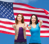 Two smiling girls showing thumbs up — Stock Photo