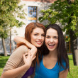 Two laughing girls hugging — Stock Photo #39274539