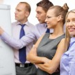 Business team with flip board having discussion — Stock Photo #39274981