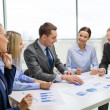 Smiling business team at meeting — Stock Photo