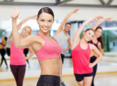 Personal trainer with group in gym — Stok fotoğraf
