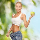 Sporty woman showing big pants — Stockfoto