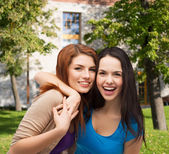 Two laughing girls hugging — Stock Photo