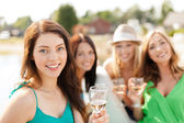 Smiling girls with champagne glasses — Foto de Stock