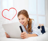 Girl with tablet pc at home — Stockfoto