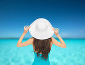 Model in swimsuit with hat — Stock Photo