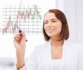 Businesswoman drawing forex chart in the air — Stock Photo