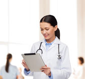 Female doctor with stethoscope and tablet pc — Stock Photo