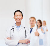 Smiling female doctor with stethoscope — Stock Photo