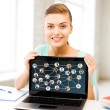 Smiling student girl with laptop at school — Stock Photo #39391359