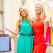 Stock Photo: Two beautiful women with shopping bags in the ctiy