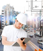 Male architect looking at blueprint — Stock Photo