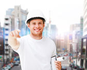 Male architect in helmet pointing at you — Stock Photo