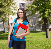 Smiling student with bag, folders and tablet pc — Stock Photo