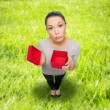 Disappointed asian woman with empty red gift box — Stock Photo