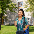 Smiling student with bag and take away coffee cup — Stock Photo