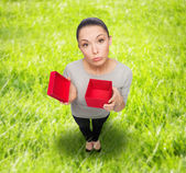 Disappointed asian woman with empty red gift box — Foto de Stock