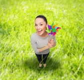 Smiling asian woman with windmill — Stock Photo