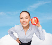 Smiling businesswoman with red clock — Stok fotoğraf