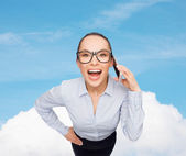Happy businesswoman in eyeglasses with smartphone — Stock Photo