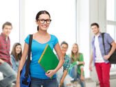 Smiling student with bag and folders — Stock Photo