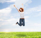 Teenage girl in white blank t-shirt jumping — Stok fotoğraf