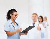 Smiling female african american doctor or nurse — Zdjęcie stockowe