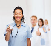 Smiling female african american doctor or nurse — Stock Photo