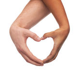 Woman and man hands showing heart shape — Stockfoto