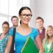 Smiling student with bag and folders — Stock Photo #39654357