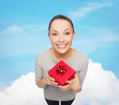 Smiling asian woman with red gift box — Stok fotoğraf